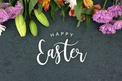Happy Easter Text With Beautiful Colorful Flowers Bouquet Border. Shot From Directly Above Over Black Dark Texture Background, Horizontal Stock Photos