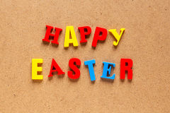 Happy Easter text on cardboard background Royalty Free Stock Images