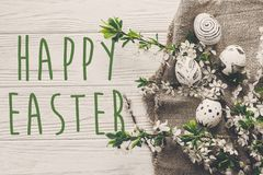 Happy Easter Text Flat Lay With Flowers And Stylish Eggs On Rust Royalty Free Stock Images