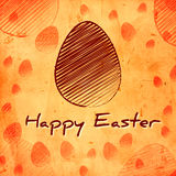 Happy Easter and brown egg over orange old paper background Royalty Free Stock Photos
