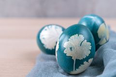 Happy easter, three organic blue easter eggs standing on the wooden table, easter holiday decorations, easter concept backgrounds. With copy space stock photo
