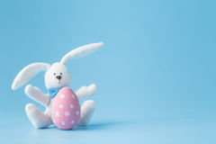 Happy Easter - Toy rabbit and easter eggs Royalty Free Stock Photography