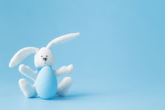 Happy Easter - Toy rabbit and easter eggs Royalty Free Stock Photo