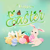 Happy Easter typographical background with bunny rabbit. Stock Image