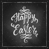 Happy Easter typographical background. Happy Easter - hand drawn chalk lettering on chalkboard, Happy easter card, Happy Easter text for greeting card, poster Royalty Free Stock Photo