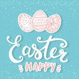 Happy Easter typographical and eggs on holiday background with light and stars. Royalty Free Stock Image
