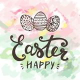 Happy Easter typographical and eggs on holiday background with light and stars. Stock Photography
