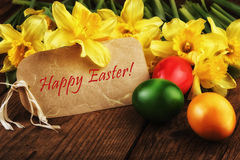 Happy Easter vintage card with yellow flowers sunlight effect Royalty Free Stock Photography