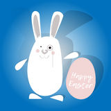 Happy easter. White rabbit with pink egg. Bunny with monocle. Blue background. Greeting card. Stock Images