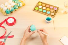Happy easter, women is painting the easter eggs for easter day festival holiday, easter concept backgrounds with copy space Stock Photos