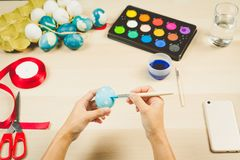 Happy easter, women is painting the easter eggs for easter day festival holiday, easter concept backgrounds with copy space Royalty Free Stock Photos