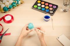 Happy easter, women is painting the easter eggs for easter day festival holiday, easter concept backgrounds with copy space Royalty Free Stock Photo
