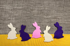 Happy easter: wooden background with rabbits for a greeting card Stock Images