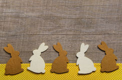 Happy easter: wooden background with rabbits for a greeting card Stock Photos