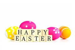 Happy Easter wooden blocks with Easter eggs over white Royalty Free Stock Photography