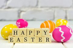 Happy Easter wooden blocks with Easter eggs Stock Photos