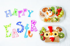Happy Easter words with school lunch boxes for kids with food in Royalty Free Stock Images