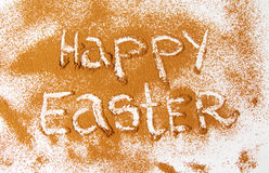 Happy Easter written in cacao powder stock photography