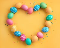 Yellow background with colorful easter eggs. Happy Easter! Yellow background with colorful easter eggs. Top view with copy space Royalty Free Stock Photos