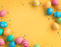 Yellow background with colorful easter eggs. Happy Easter! Yellow background with colorful easter eggs. Top view with copy space Royalty Free Stock Photography