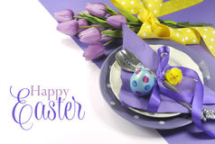 Happy Easter yellow and purple mauve lilac theme easter table place setting stock images