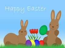 Happy Eastern, Easter Bunnys with Eggs and tulip on grassland Royalty Free Stock Photos