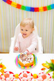 Happy eat smeared baby eating first birthday cake Stock Images