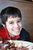 Happy Eater. Adorable boy is enjoying a delicious dessert of a brownie sundae Royalty Free Stock Image