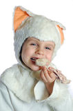 Happy eating cat. Child dressed as a kitten eating chicken Royalty Free Stock Photos