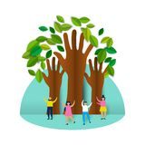 Happy eco friendly people group with paper trees Royalty Free Stock Photo