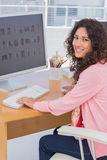 Happy editor at her desk royalty free stock images