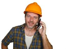 Happy efficient and cheerful workman or contractor man wearing builder hat tallking with satisfied customer on mobile phone stock image