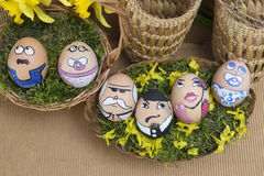 Happy egg face family in wicker basket Royalty Free Stock Photo