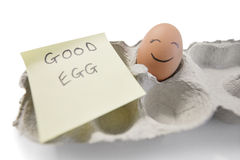 Happy egg with a note written 'good egg' Royalty Free Stock Images