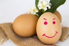 Happy eggs writing face on eggs healthy foods stock images