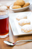 Happy Eid. Kahk El Eid with glass of tea - Eid El Fitr Stock Photo