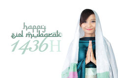 Happy Eid Mubarak 1436 H. Asian muslim girl and 'Happy Eid Mubarak 1436 H' typography illustration, over white background Stock Photography