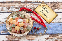 Happy Eid text in turkish on the card with turkish delights Royalty Free Stock Photos