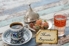 Happy eid text in turkish on greeting card with turkish coffee, Stock Photography