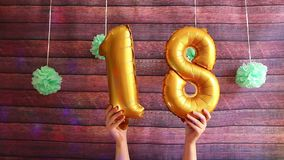 Happy eighteen birthday, golden air balloons with number 18, anniversary. Celebration with decorations stock video