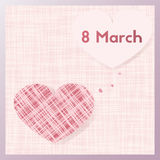 Happy eighth of March. Greeting card with background fabric. Happy eighth of March. Greeting card template with background fabric. Decorated with heart shape Royalty Free Stock Photo