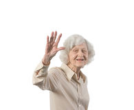 Happy Elder Lady Waving Stock Image