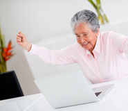 Happy elder woman with arms up Royalty Free Stock Photos