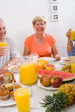 Happy elderly. People having healthy breakfast together Royalty Free Stock Images