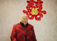 Happy elderly Asian Chinese 90s old woman portrait on her grandson wedding royalty free stock image