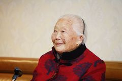 Happy Elderly Asian Chinese 90s old woman portrait laugh stock photos