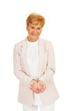 Happy elderly business woman holding copyspace or something on open palms.  Stock Photography