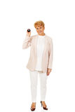 Happy elderly business woman holding eight billard-ball Royalty Free Stock Photo