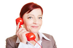 Happy business woman with red phone Royalty Free Stock Images