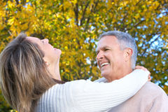 Happy elderly couple. In love in park Stock Photography